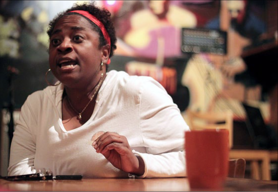 Yolanda Williams, an academic adviser of the Gateway Program, expresses her grief about racism in Charleston during Coffee Hour at JacksonAvenue Coffee on Sept. 20, 2013.