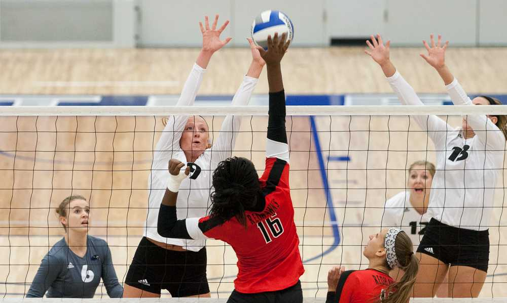 Jason Howell | The Daily Eastern News Freshman middle hitter Allie Hueston and freshman outside hitter Maria Brown attempt a block during a match against Southeast Missouri on Friday in Lantz Arena.  The Panthers lost to the Redhawks 3-2.  The Panthers beat Tennessee-Martin on Saturday 3-0 to improve to 5-7 in the OVC and 11-14 overall.