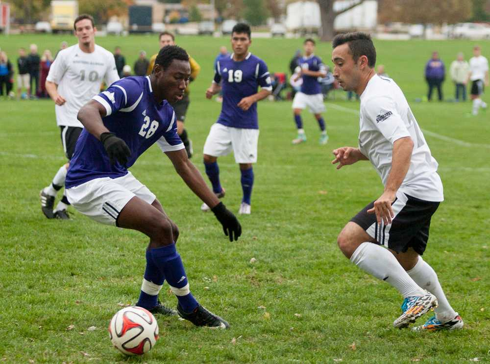 Jason Howell | The Daily Eastern News Senior Will Butler moves the ball around Western's Armel Kouassi during a match on Oct. 18 at the Eastern practice field.  The Panthers lost to the Leathernecks 1-0.