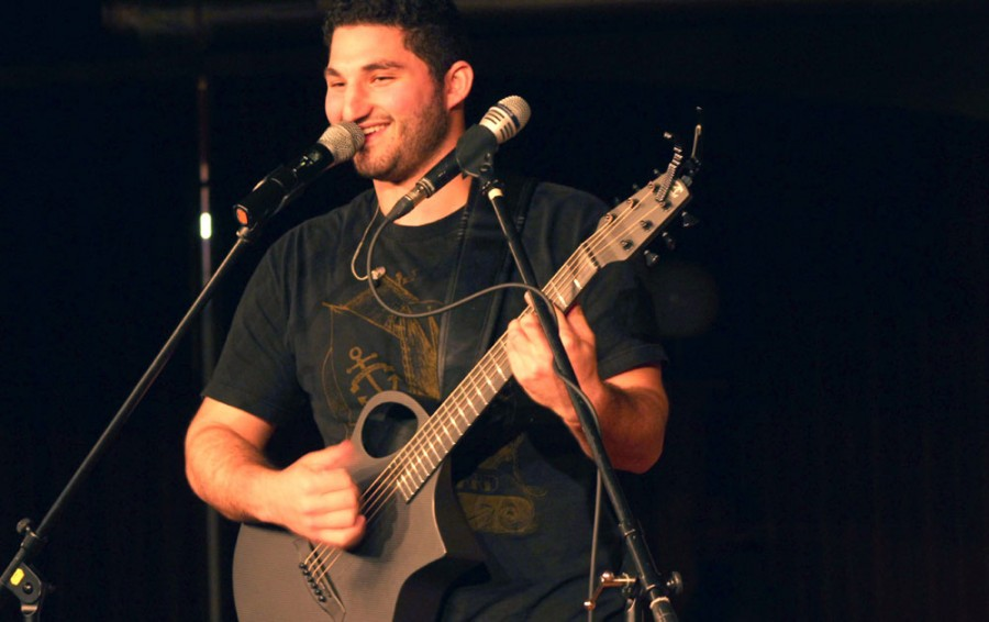 Kevin Hall | The Daily Eastern News  Dan Henig performs original songs as well as covers to some popular songs Wednesday in 7th Street Underground.