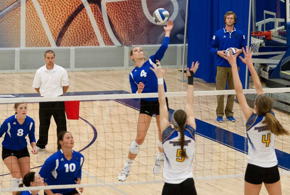 Junior outside hitter Abby Saalfrank leaps to hit the ball during the Panthers' 3-0 win over Morehead State on Nov. 8.