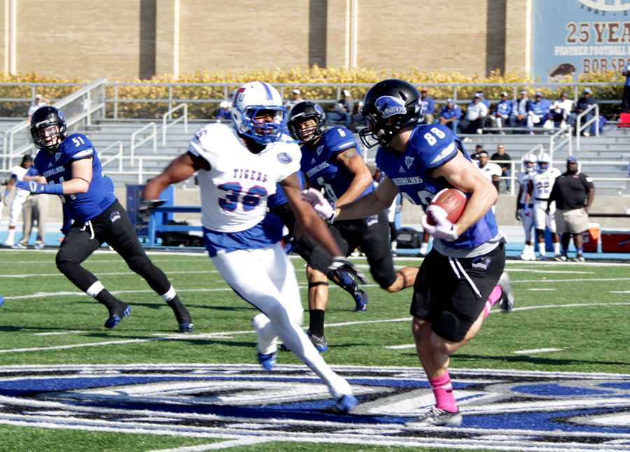 Red-shirt senior, Adam Drake runs with the ball, as Tennessee State defensive back Andrew Dale closes in on him at OBrien Field on Oct. 25. Drake is one 19 senior who will play their final game at noon Saturday at OBrien Field against Tennessee-Martin.