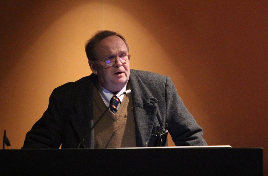 Author Joseph Carroll gives a presentation on literary Darwinism on Thursday in the Lecture Hall of the Doudna Fine Arts Center.