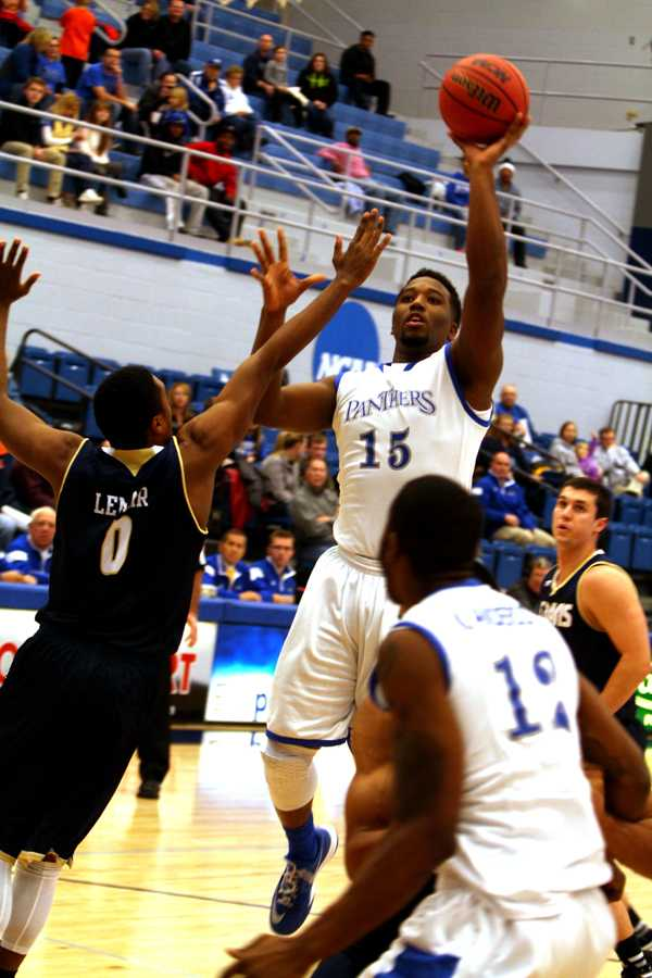 Trae Anderson,a junior forward, attempts a jump shot in the game Thursday against UC Davis in Lantz Arena. Anderson ended the game with 16 points.