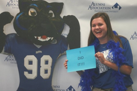 Kayla Weihe, senior family and consumer sciences major, poses with a cutout Billy the Panther Thursday at the Alumni Association's annual Grad Bash.