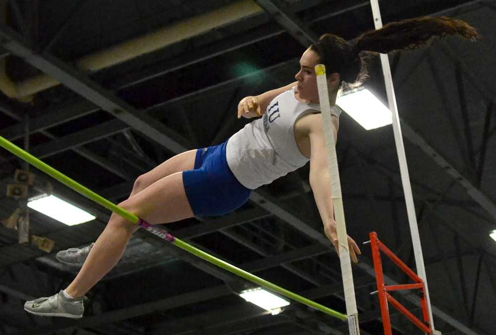 File photo | The Daily Eastern News Junior pole-vaulter Annemarie Reid, vaults the bar during the 2013 OVC Championship meet on Feb. 23 in the Lantz Fieldhouse.