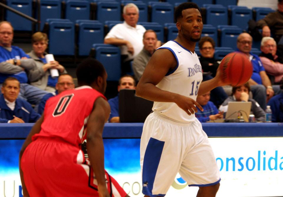 Trae Anderson, a forward, attempts to look for an open man in the game against Ball State University in Lantz Arena.