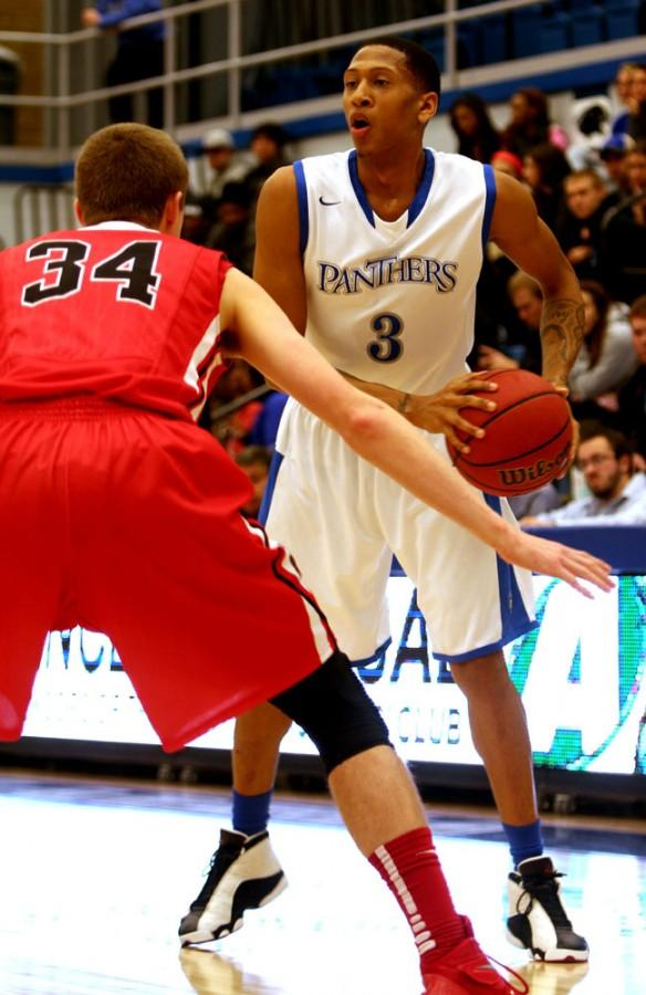 LeTrell+Viser%2C+a+guard%2C+looks+for+an+assist+in+the+game+against+Ball+State+Wednesday+in+Lantz+Arena.+Viser+was+third+in+leading+the+team+in+scoring.