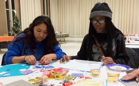 Sophomore nursing major Blanca Aragon and sophomore applied engineering and technology major Sandra Coleman make decorations during the Global Traditions event on Tuesday in the University Ballroom of the Martin Luther King Jr. University Union.  Aragon was making a reindeer ornament while Coleman was making a