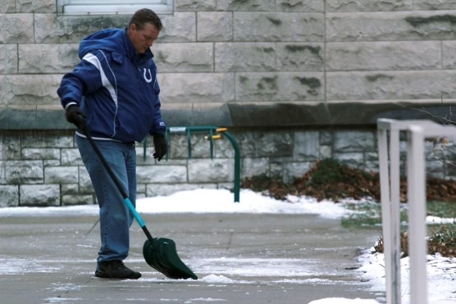 Robert Wells, a building service worker in Blair Hall, shovels ice off of the sidewalks Monday outside of Blair Hall. Wells started shoveling ice around 4 a.m. on Monday morning. Wells said that workers go and shovel ice around two or three times a day during this weather.