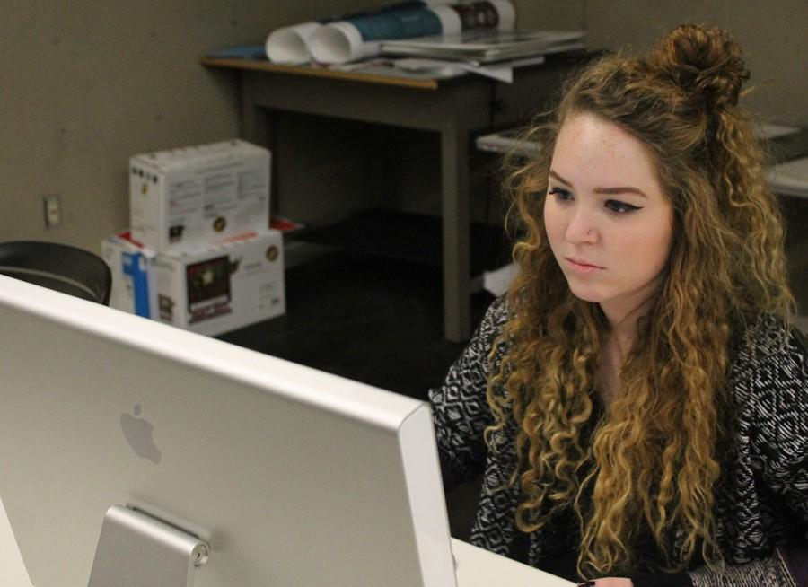 Zoe Volk,a junior graphic design major, working on projects in the Doudna computer lab.