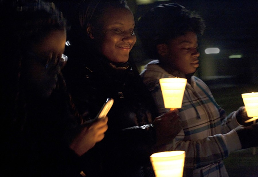 Jasmine Thomas, a freshman political science major, and Ivory Parker, a freshman Spanish major, hold their candles as they march to the Martin Luther King Jr. University Union Monday during the Martin Luther King Jr. vigil on Jan. 20, 2014.