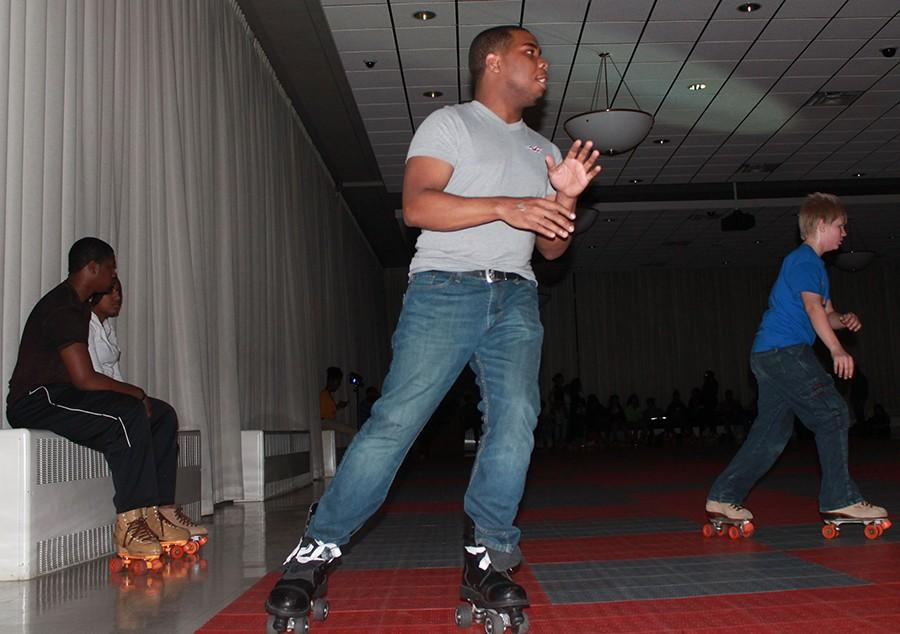 """Corinthian Bethel, a senior family and consumer sciences major, roller skates for the """"Rollbouce"""" event during Up All Nite Friday in the University Ballroom in the Martin Luther King Jr. University Union."""