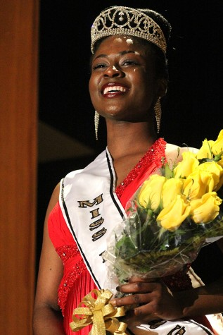 Shadaje Johnson, a senior family and consumer sciences major, takes her first walk as the winner of the Miss Black and Gold pagent Saturday in the Grand Ballroom of the Martin Luther King Jr., University Union.