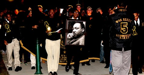 Reginald Thedford and Phillip Love, memebers of Alpha Phi Alpha Fraternity INC. lead the march for the Dr. Martin Luther King Jr. Celebration and Candle Light Vigil Monday. The men of Alpha Phi Alpha lead the march from Thomas Hall to the Martin Luther King Jr. University Union.