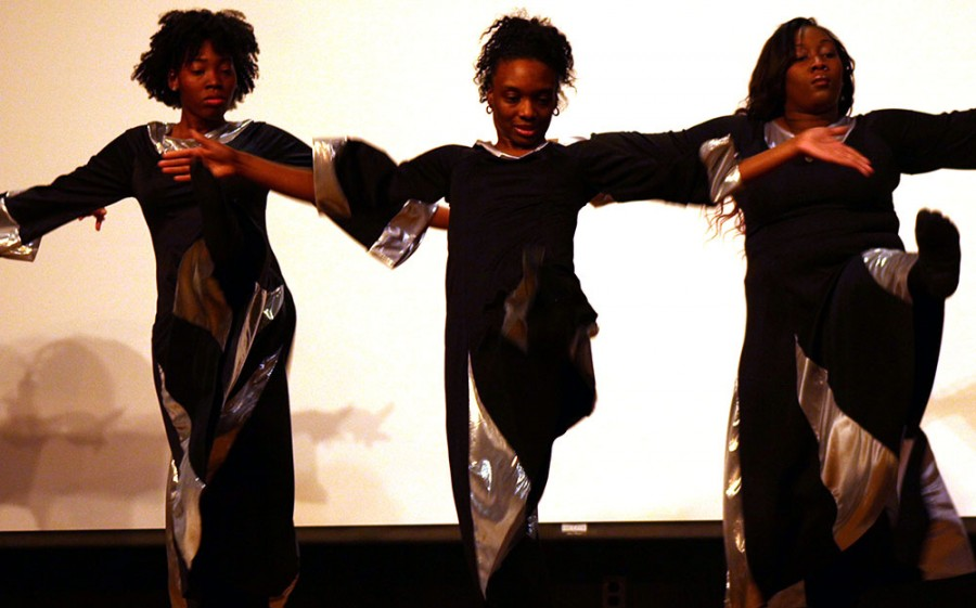 Ke'Ana Lampkins(Left), Tania Stanford(Middle), and Elizabeth Bailey(Right) perform a praise dance during the Martin Luther King Jr. Celebration and Candle Light Vigil Monday at the Martin Luther King Jr. University Union in the Grand Ballroom.