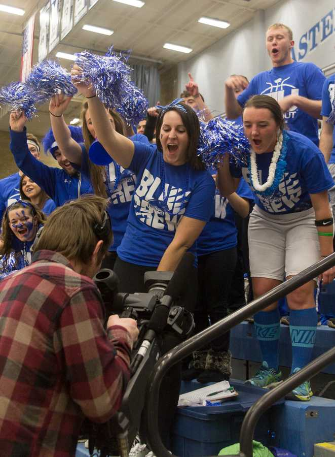 Sophomore communication disorder and sciences major Kersten Kidd, along with senior elementary educaiton major Lindsay Anderson and other members of the Blue Crew, play for the camera during the men's basketball 77-62 loss to Murray State on Thursday at Lantz Arena.  4,542 people were in attendance for the standing room only game, which was televised on CBS Sports Network.