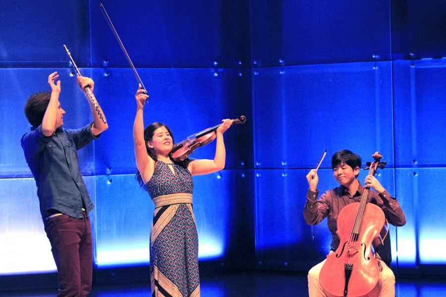 The members of Sonic Escape: Maria Kaneko Millar, Shawn Wyckoff, and Nan-Cheng Chen finish their performance with joy on Saturday in the Concert Hall of The Doudna Fine Arts Center.