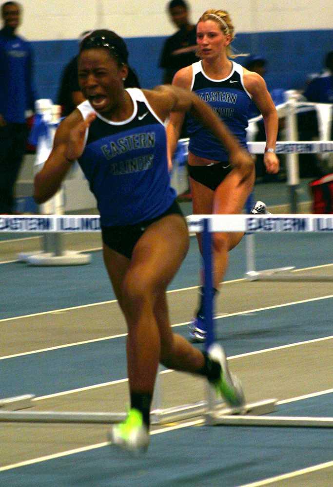 Darneisha Spann, a freshmen elementary major, runs hurdles during the John Craft Invite Sat. in the Lantz Arena Indoor Fieldhouse.