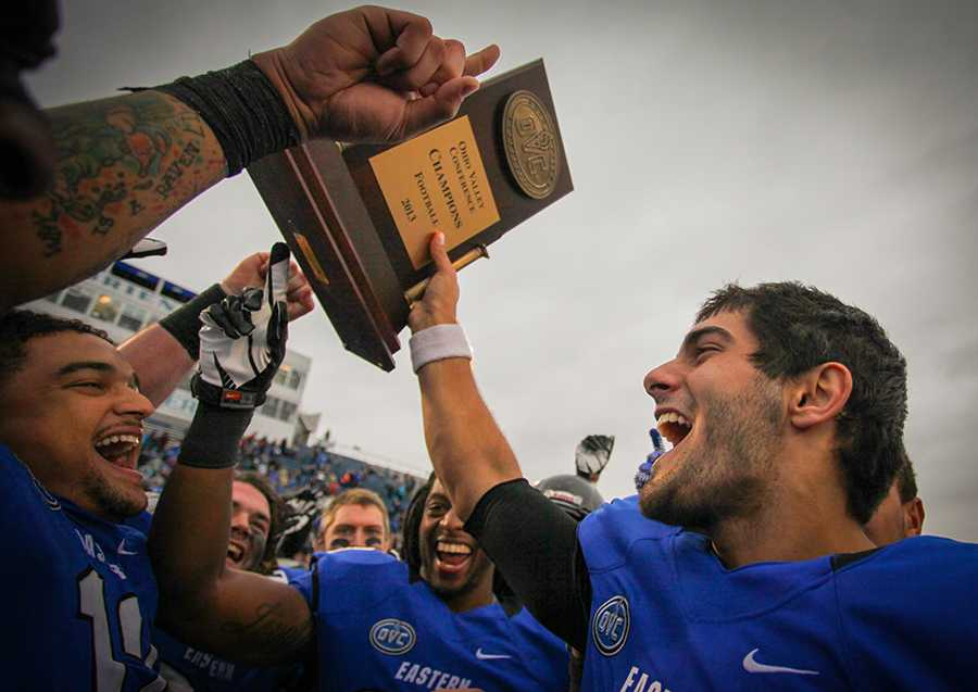 Former Eastern quarterback Jimmy Garoppolo and the Eastern football team celebrate, winning the Ohio Valley Conference title for the second straight year with a 52-14 win over Jacksonville State at O'Brien Field on Sept. 16, 2013.