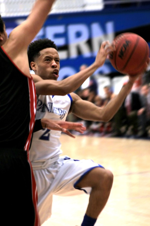 Freshman guard Cornell Johnston attempts to go up against a defender in the men's basketball game Saturday in Lantz Arena against Southern Illinois University-Edwardsville. Johnston scored 12 points for the Panthers.