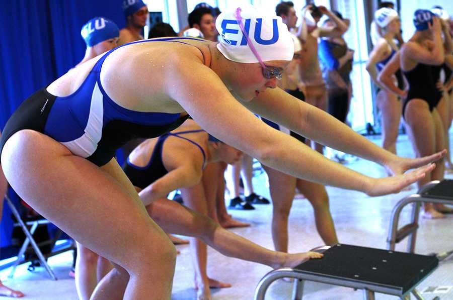 Freshman Nicole Beringer competes in the women 400 yard Medley relay Friday at the Padovan Pool. Both the men's and women's swim teams ended their season Friday in St. Louis.