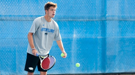 Freshman Grant Reiman prepares to serve the ball during tennis practice on Sept. 30.