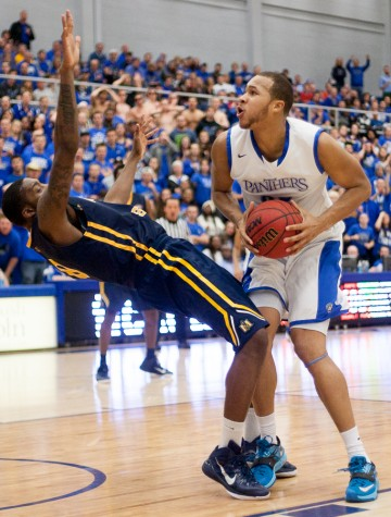 Junior forward Chris Olivier knocks a Murray State player on his back as he goes up for a shot during the Panthers' 77-62 loss to the Racers on Jan. 22 in Lantz Arena.  Olivier scored 17 points for the Panthers.  The Panthers go into Saturday's game at SEMO 7-3 in the OVC.