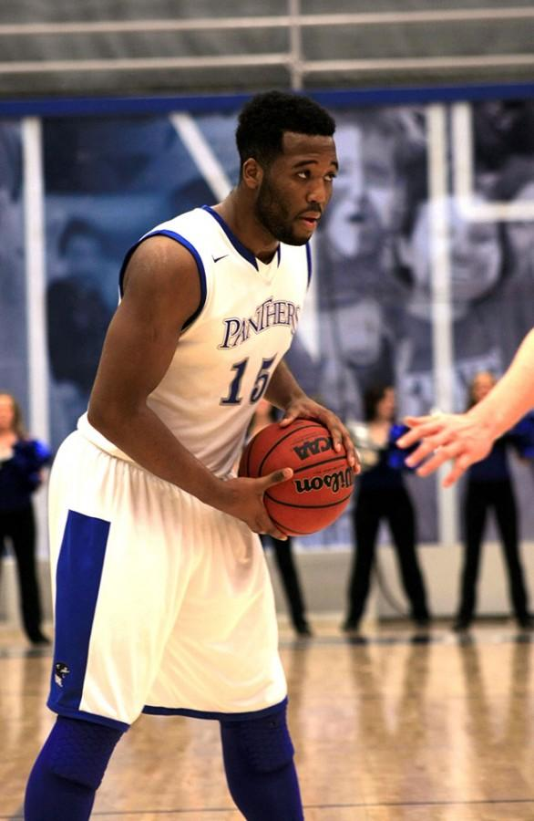 Trae Anderson, a junior forward, looks to pass the ball in the men's basketball game Tuesday Feb.3 against Baker University. The Panthers beat Baker's University with the score of 59 to 32.