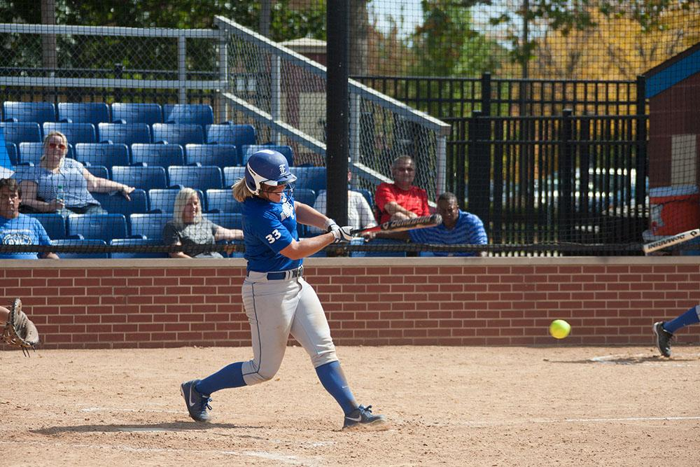 Senior catcher Hannah Cole swings at a pitch during a game against Central College.