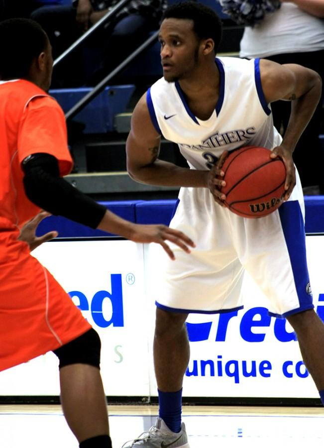 Dylan Chatman, a senior guard, looks to get around a defender in the men's basketball game against Baker University Tuesday Feb.3rd in Lantz Arena. Chatman only managed 3 points in the game.