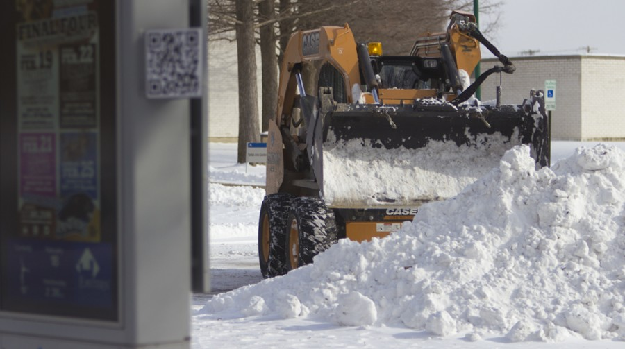 An Eastern groundskeeper uses a skid steer to plow snow on Wednesday near Buzzard Hall.  According to the National Weather Service, temperatures are expected to reach a high of 8 degrees and drop to 2 degrees below zero.  The high on friday is exptected to be 21 degrees with a 30 percent chance of snow.
