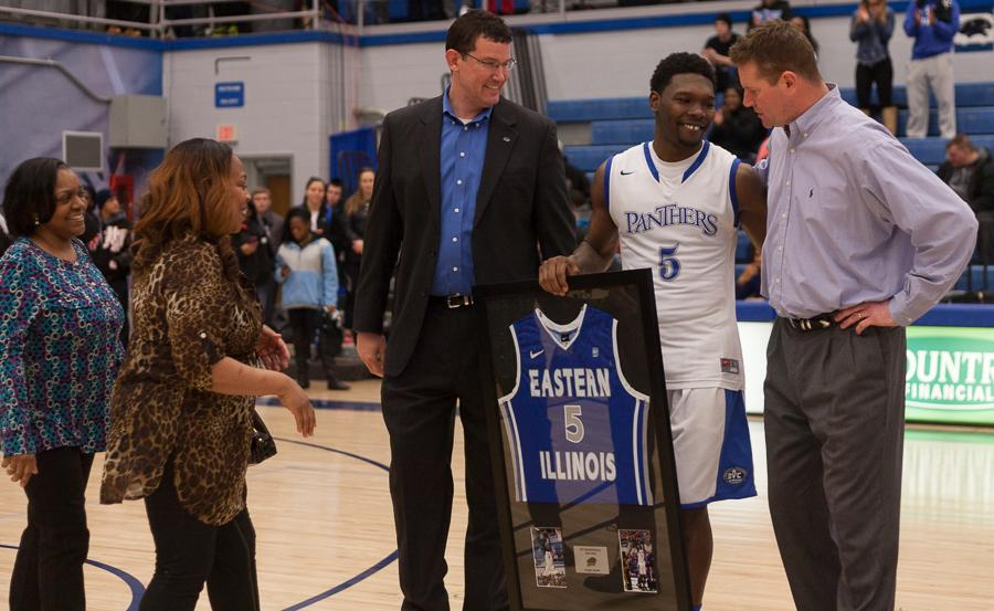 Senior guard Reggie Smith shares a hug with Eastern coach Jay Spoonhour as graduating seniors are recognized after the Panthers' 73-65 win over the Southeast Missouri Redhawks on Sunday at Lantz Arena.  Smith averaged 7.3 points per game over 26 games played during his career at Eastern.