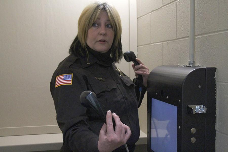 Coles County Sheriff Lieutenant and jail administrator Lisa Tills demonstrates how the virtual visitation room is used Friday in the Coles County Sheriffs Office.