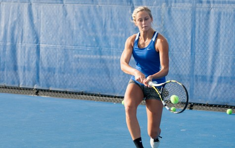Junior Ali Foster returns the ball during tennis practice on Sept. 30 at the Darling Courts.
