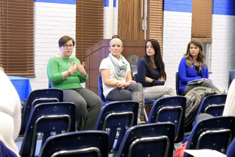 Heather Webb, Deputy Title IX Coordinator, speaks to students, faculty and staff members during It's On Us: Take a Stand Against Sexual Assault panel in the Charleston/Mattoon Room of the Martin Luther King Jr. University Union on Tuesday. Lindsay Wilson, a counselor at the Eastern Counseling Center, Marlene Acosta, a senator on Student Government, Melany Zwiling, the Sexual Health Education Coordinator at the Health Education Resource Center and Nathan Gayheart, president of Interfraternity Council were also on the panel.