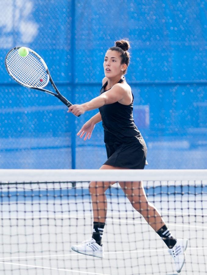 Senior Sephora Boubahaiem hits the ball during a match against Olivet Nazarene on Oct. 6 at the Darling Courts.