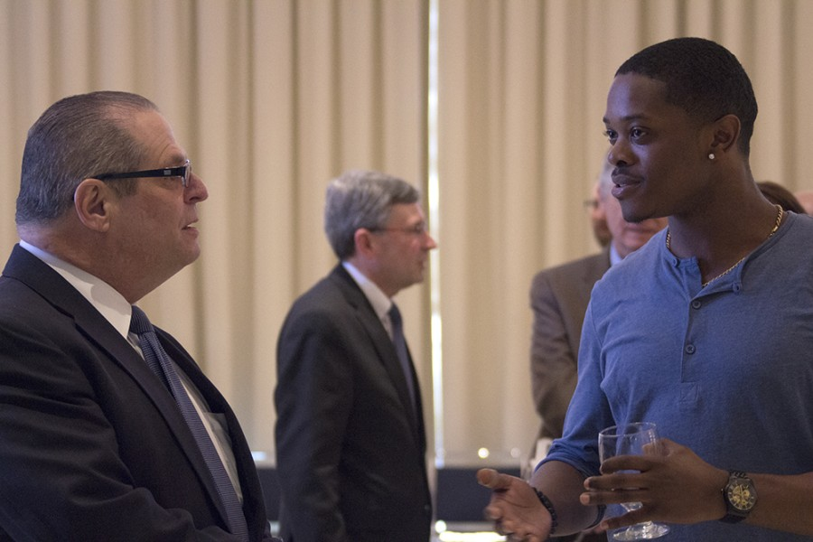 Newly appointed president of Eastern, David Glassman, speaks with student body president Reginald Thedford, Jr., a senior political science major Monday after the Board of Trustees Meeting in the University Ballroom in the Martin Luther King Jr. University Ballroom.