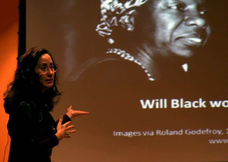 Dr. Angharad N. Valdivia, an associate professor at the University of Illinois Urbana-Champaign, discusses gender and race issues displayed in the media at the Brain, Brow, or Bootie?: Contemporary Latinidad in Popular Culture presentation in the Doudna Fine Arts Center Thursday in the Lecture Hall. Dr. Valdivia mentions several examples in today's society that are ambiguously placed in advertisements.