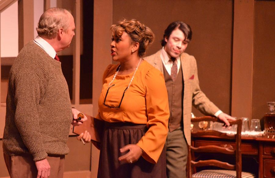 Tim Mason, an economics professor, Leah Davis, a senior communications major, and Rico Torres, junior theatre major, acts as Major Mercalf, Mrs. Boyle, and Paravicini in the performance, Mousetrap, at Doudna Fine Arts Center Thursday in the Theater.