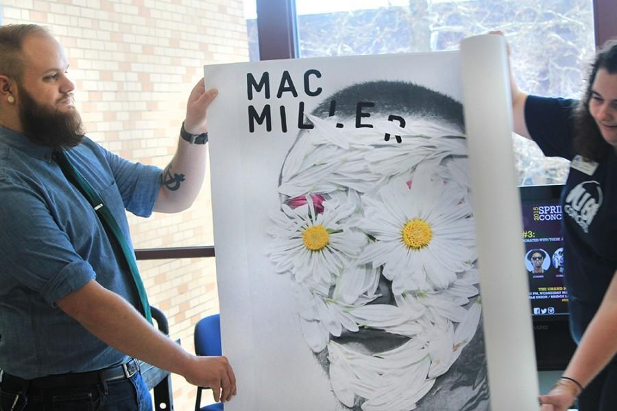 Canaan Daniels, a student life graduate assistant, unveils the Spring Concert artist, Mac Miller Wednesday in the Bridge Lounge in the Martin Luther King Jr. University Union. He will be performing at 8 p.m. April 25 in the Lantz Arena.