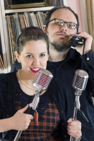 Carrie and Scott Wallace pose with vintage microphones from their collection in their Charleston home, which also doubles as a local studio.