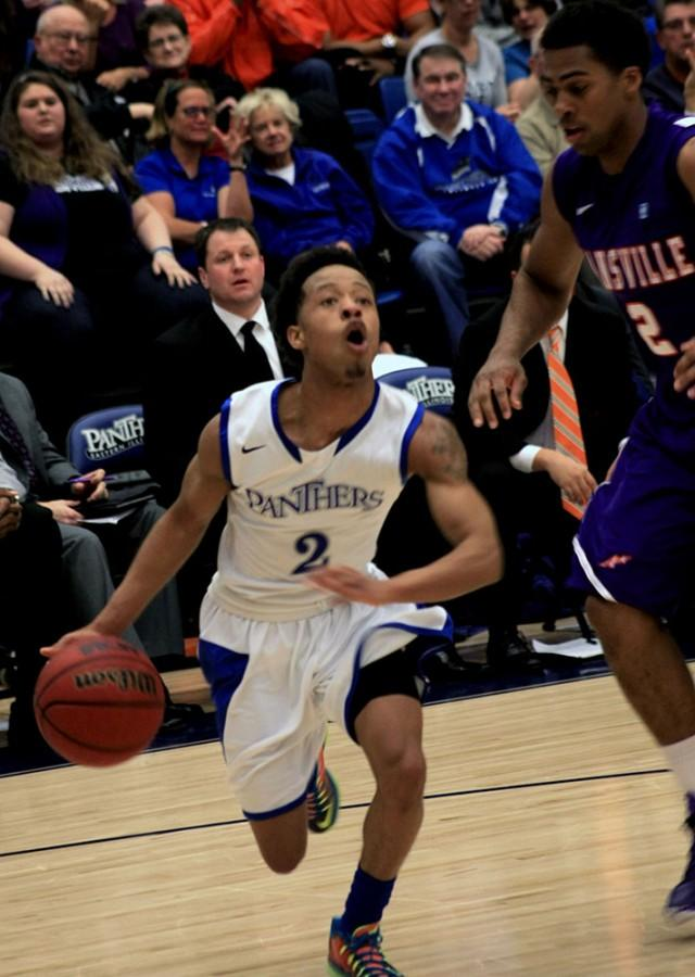Cornell Johnston, a freshmen guard, runs around a defender in the men's basketball game Monday in Lantz Arena against Evansville. Johnston had a total of 7 points in the game.