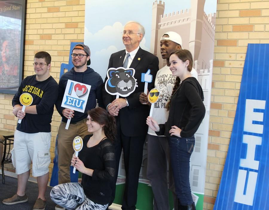 Students take photos with President Bill Perry at the Martin Luther King Jr. University Union Bridge Thursday afternoon as a part of the Photos with the Prez event.