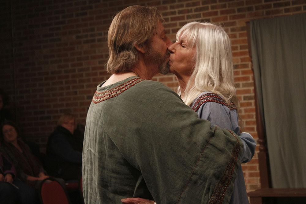 """Henry II, played by Duke Bagger, and Eleanor of Aquitaine, played by Linda Bagger, share a kiss as a way of settling their differences in the play """"The Lion in Winter"""" at the Charleston Alley Theater."""