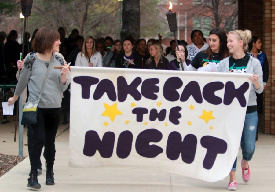Students, faculty members and Charleston residents begin  their march from the Martin Luther King Jr. University Union to Old Main during Take Back the Night on April 10, 2014. People joined in as the marchers passed by, shouting chants such as,