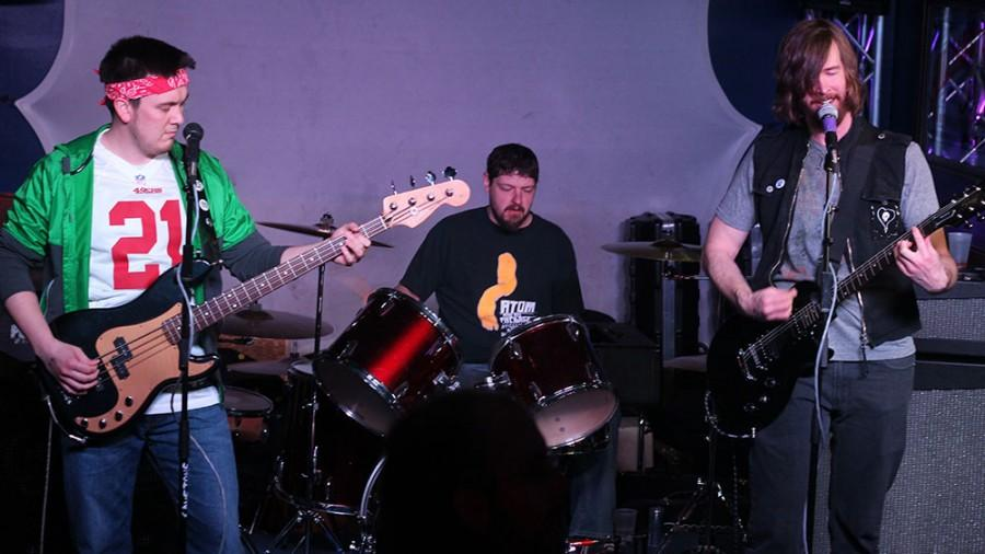 The Band The Tim Blys sings the batman theme  at the Cavetone Records Seven Year Anniversary Spectacular at the Top of the Roc on Saturday.