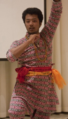 """Sunrose Maskey, a freshman psychology major performs a Napali dance to Shakira's """"Waka Waka"""" song evening for Sounds of the World on October 14,2014."""