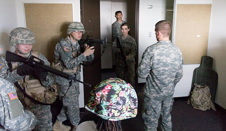 Senior accounting major Matthew Bailey, as squad leader, explains the procedures to clearing rooms to cadets on Thursday in Carmen Hall.