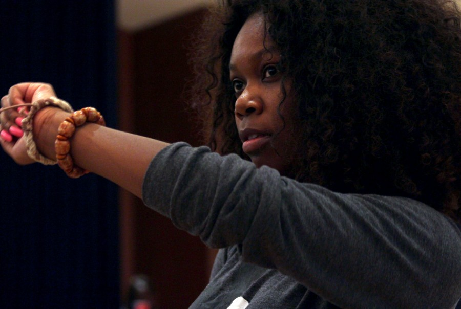 Faythe Missick, a graduate student studying international comparitive politics, poses as she models her wrist wear in the ASA fashion show rehearsal at the Martin Luther King Jr. University Union Thursday.
